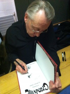 Bryan Talbot signs my copy of Grandville. Both he and Mary were very friendly and approachable.